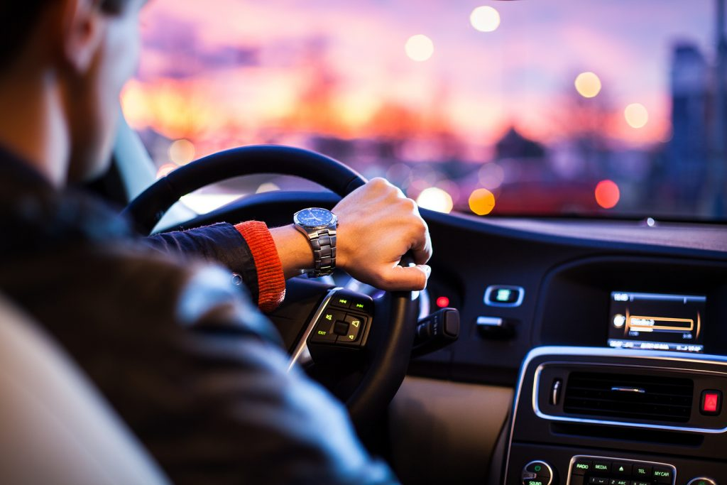 Driving a car at night -man driving his modern car at night in a