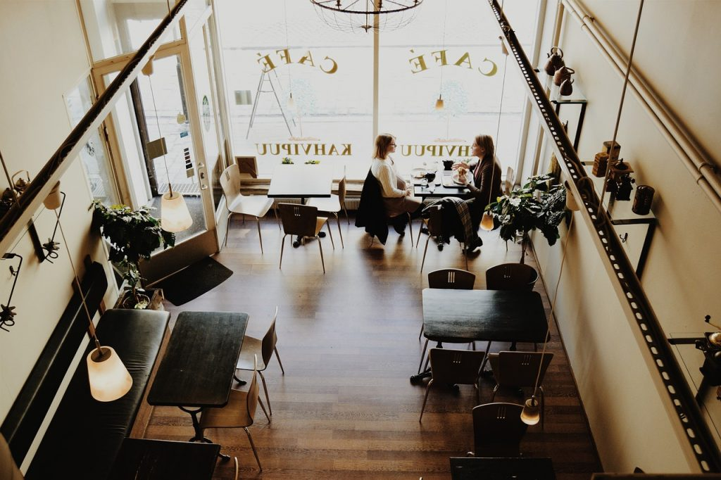 Arial view of 2 people at a coffee shop