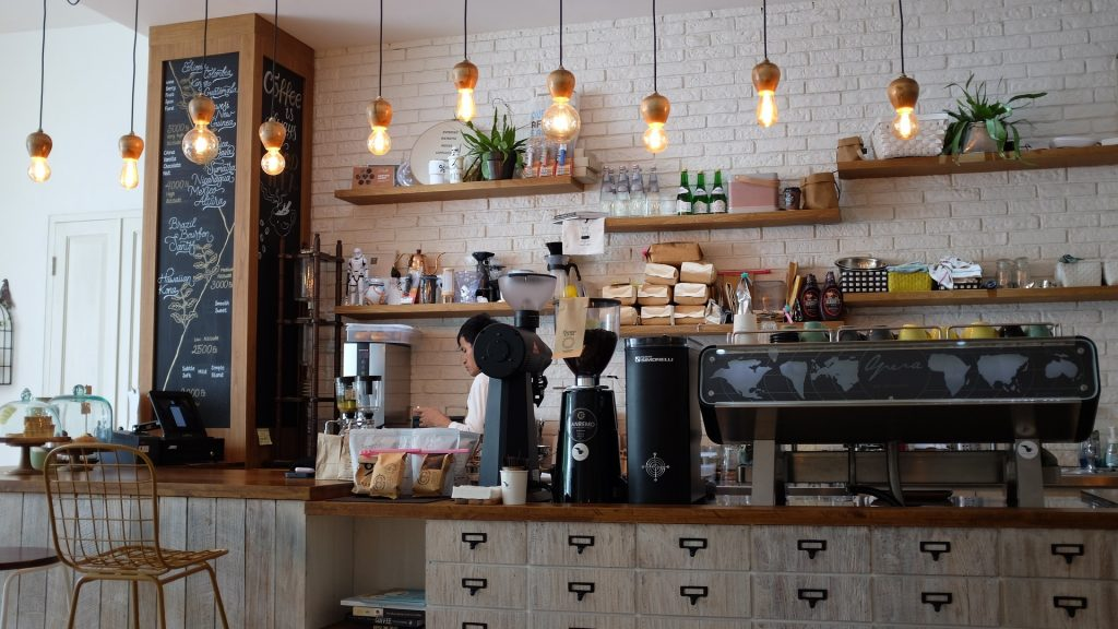 Coffee Shop image with man working behind the counter