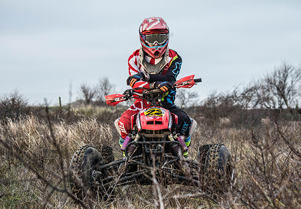 ATV Rider in the brush posing for picture